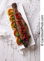 grilled rainbow trout with vegetables. vertical top view