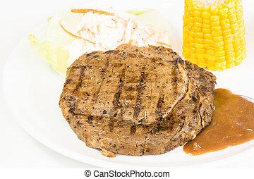 Grilled rib eye steak, corn on the cob and salad