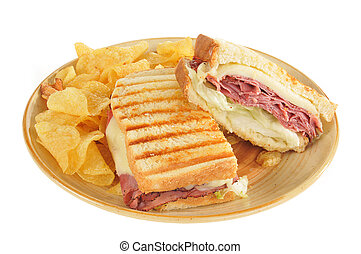 Grilled roast beef and panini sandwich and chips