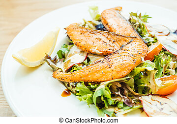 Grilled salmon fillet meat with vegetable salad