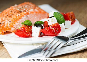 Grilled salmon on plate with greek salmon