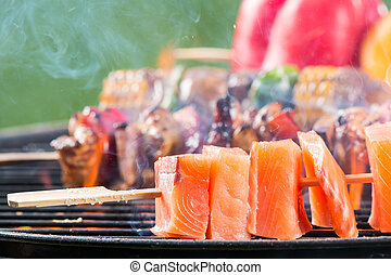 Grilled salmon skewer on fire