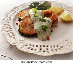 Grilled salmon steak with sauce