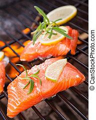Grilled salmon steaks on fire
