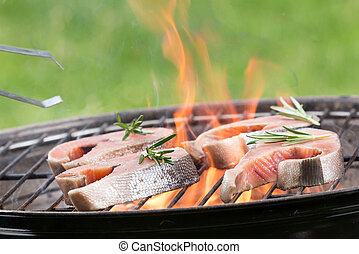 Grilled salmon steaks on the grill