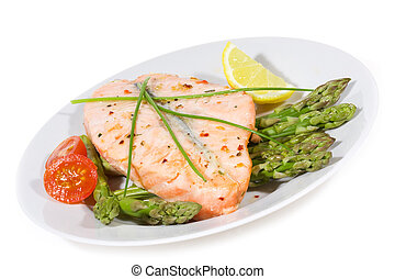 grilled salmon with vegetables on white background