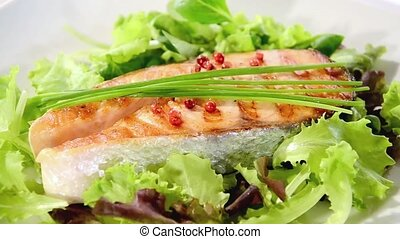 Grilled salmon steak rotating
