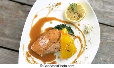 Grilled salmon, vegetables and sauce. Delicious restaurant...