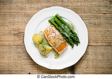 Grilled salmon with boiled potatoes and asparagus. Top view