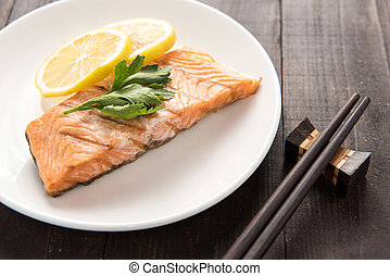 Grilled Salmon with lemon on dish