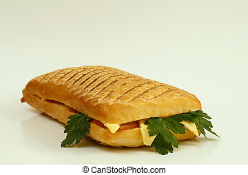 Grilled sandwich with ham and cheese
