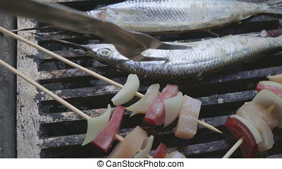 Grilled sardines - Fish on grill with vegetables and fruits