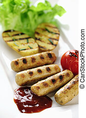Grilled sausage and potatoes with ketch-up