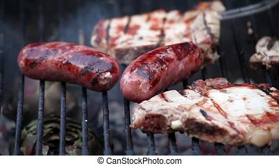 Grilled Sausages And Steaks - Video clip of sausages and...