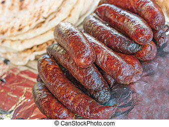 Grilled sausages on a fair stall, selective focus