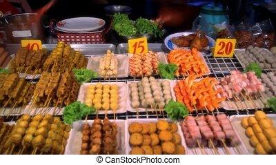 Grilled sausages on a night market. Thailand Koh Samui -...