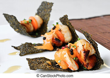 grilled scallops with sour sauce on crispy seaweed