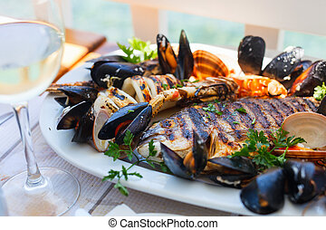 Grilled seafood platter - Close up of delicious grilled ...