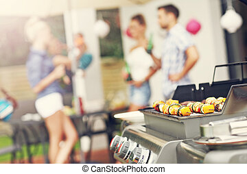 Grilled shashliks and hamburgers on grate - Closeup of...