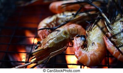 Grilled shrimp (Giant freshwater prawn) grilling with charcoal for sale at Thai street food market or restaurant in Bangkok Thailand