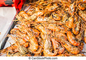 Grilled shrimp on a tray.