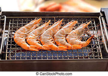 Grilled shrimp or easy BBQ grilled shrimp on electric grill., Closeup - Frozen shrimp, fresh shrimp, sausage or bacon strips use indoor electric grill if the weather is not good for outside grilling.
