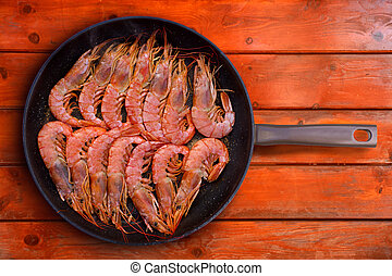 grilled shrimp seafood in round pan in a row