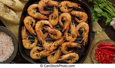 Grilled shrimps in cast iron grilling pan with fresh lemon, ...