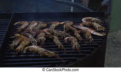 Grilled shrimps on flaming grill, seafood barbecue