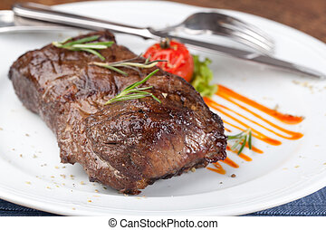 Grilled sirloin steak on a white plate
