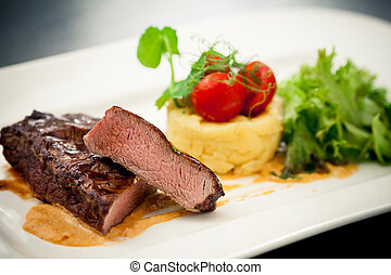 Grilled sirloin with hummus, bacon, cream and plum sauce and...