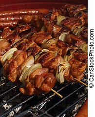 Grilled skewers, closeup - Skewers with meat and onion...