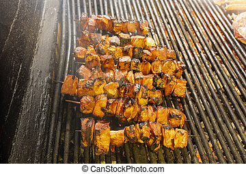 Grilled skewers of vegetables and meat on the grill