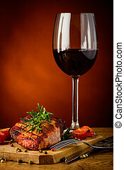 grilled steak and glass of red wine