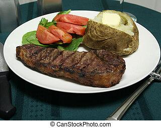 Grilled Steak dinner with utensils - Steak dinner with a...