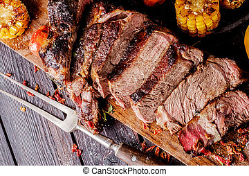 Grilled steak sliced on a cutting board. Entrecote with...