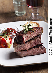 grilled steak sliced on a plate