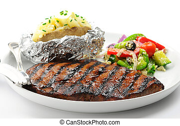 Grilled Steak - Grilled steak with baked potatoes and salad.