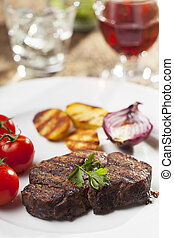 grilled steak with parsley on a plate