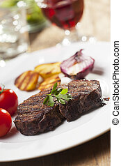 grilled steak with potatoes on a plate