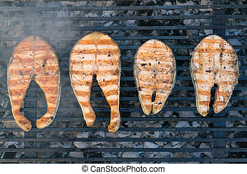 grilled steaks of salmon on the grill