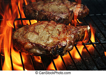 Grilled Steaks - Two Juicy stakes grilling on the barbeque ...