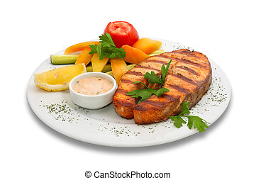 Grilled sturgeon fish with fresh vegetables. served on the plate with yellow pepper, cucumber and tomato