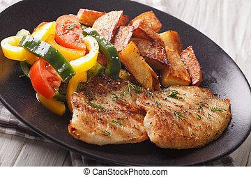 Grilled Tilapia fillet, fried potatoes, fresh salad close-up. horizontal