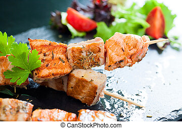 Grilled tuna and salmon brochettes. - Macro close up of ...