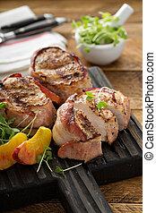 Grilled turkey tenderloins with bacon