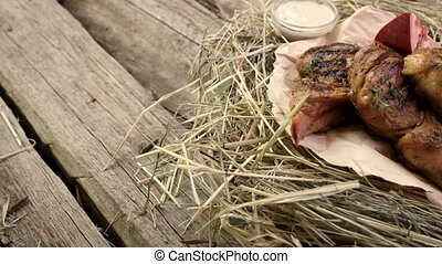 Grilled veal rib steaks. Food lying on straw.