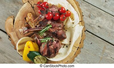 Grilled veal ribs and vegetables. Food top view.