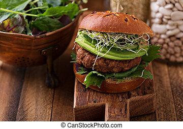 Grilled vegan bean burger with greens