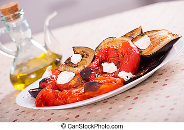 Grilled vegetables on table